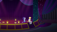 Rarity and Ragamuffin sit on the stage EGSB