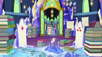 Castle throne room filled with research books S5E23