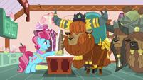 Mrs. Cake gives yaks cake while laughing nervously S5E11