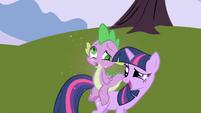 Spike dizzy on Twilight's back S1E01