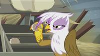 Gilda holding a scone S5E8