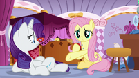 Fluttershy offers helping hoof to Rarity S9E19