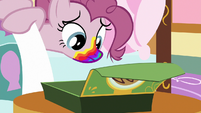Pinkie Pie looking at her cookie box S6E15