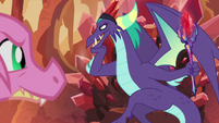 Scales looking at the Dragon Lord S8E16