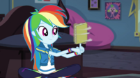Rainbow Dash spinning a notebook on her finger EGDS6