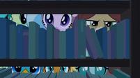 Young Six peeking behind the shelves S8E25