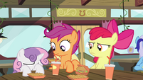 Sweetie hides her face behind the table S4E15
