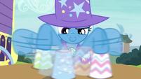 Trixie shuffling the paper cups S7E24