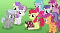 Apple Bloom holding a friendship journal copy S7E14