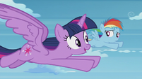 Twilight flying alongside Rainbow Dash S5E25
