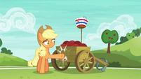 Applejack lightly kicking the ball cart S6E18