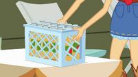Applejack sets down bucket of cider bottles EG