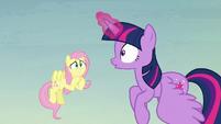 Twilight surprised; Fluttershy grinning nervously S5E23