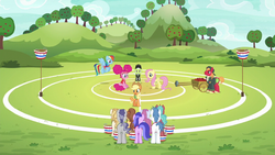 Applejack on buckball field explaining buckball to the unicorns S6E18.png
