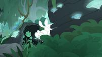 Fluttershy hops through log's opening S9E18