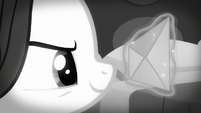 Rarity looking determined at an envelope S5E15