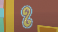 Door handle in Rarity's magic aura S9E24