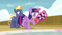 Twilight holding the race flag next to Star Tracker S7E22