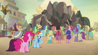 Rainbow, Pinkie, and A. K. in the village square S7E18
