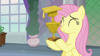 Fluttershy with Teacher of the Month trophy S8E9