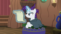 Rarity sitting on Zecora's lounge chair S7E19