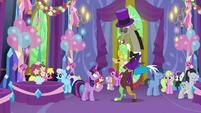 Discord returns to normal size in a purple suit S7E1
