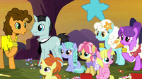 Ponies line up in front of Cheese Sandwich S9E14