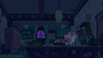 Mrs. Cake in the far corner of the kitchen S6E15
