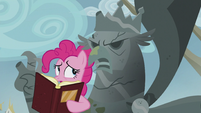 Pinkie removes the book off of the King Grover statue's face S5E8