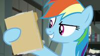 Rainbow Dash holding A. K. Yearling's folder S7E18