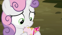 Sweetie Belle looking at Big Mac's invitation S8E10