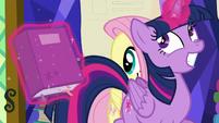 Twilight giddily trots past Fluttershy S5E23