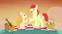 Bright Mac holding Pear Butter's hoof S7E13