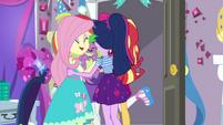 Rarity's friends gather around to hug her EGDS40