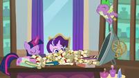Spike dumps binders and scrolls on Twilight's desk S8E15