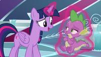 Twilight Sparkle magically levitating Spike S8E7