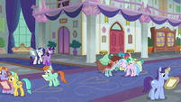 Young Six and students reading the flyer S8E16