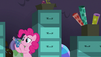 Pinkie Pie holding a party hat S9E26