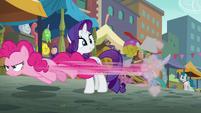 Pinkie Pie speeding past Rarity S6E3