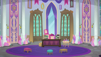 Twilight looking at papers in her office S8E25