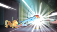 Applejack trying to pull Rainbow out of the comic book S4E06