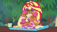 Tall pile of sugary food in front of Sunset CYOE11c