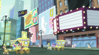 Twilight and Manehattan ponies look at bilboards S7E14