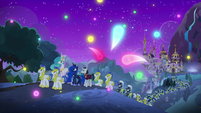 Wisps of magic float around Canterlot S8E26