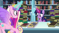 Cadance shows Twilight the book Trotter's Tome of Reliquary S6E2