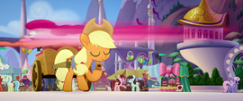 Pinkie Pie speeding over Applejack MLPTM