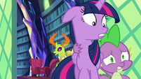 Spike drags Twilight Sparkle out of the library S7E15