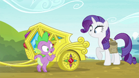 Spike next to Rarity's jeweled chariot S4E23