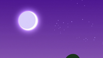 Full moon shining over the forest S9E13