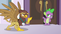 Spike helping the Griffonstone delegate S5E10